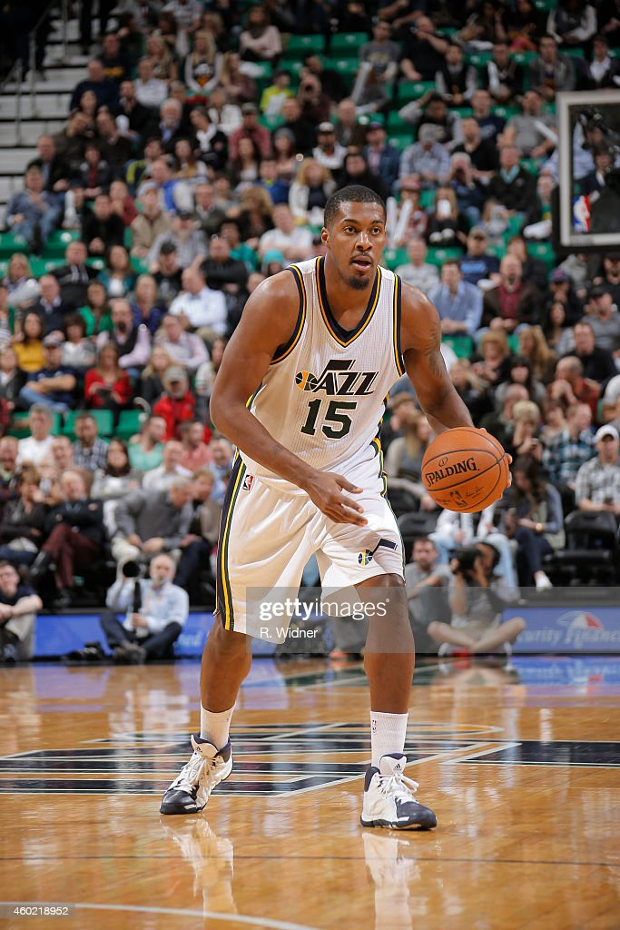 Derrick Favors of the Utah Jazz brings the ball up court against the San Antonio Spurs at EnergySolutions Arena on December 9 2014 in Salt Lake City...