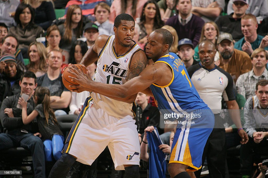 <a gi-track='captionPersonalityLinkClicked' href=/galleries/search?phrase=Derrick+Favors&family=editorial&specificpeople=5792014 ng-click='$event.stopPropagation()'>Derrick Favors</a> #15 of the Utah Jazz controls the ball against <a gi-track='captionPersonalityLinkClicked' href=/galleries/search?phrase=Carl+Landry&family=editorial&specificpeople=4111952 ng-click='$event.stopPropagation()'>Carl Landry</a> #7 of the Golden State Warriors at Energy Solutions Arena on December 26, 2012 in Salt Lake City, Utah.