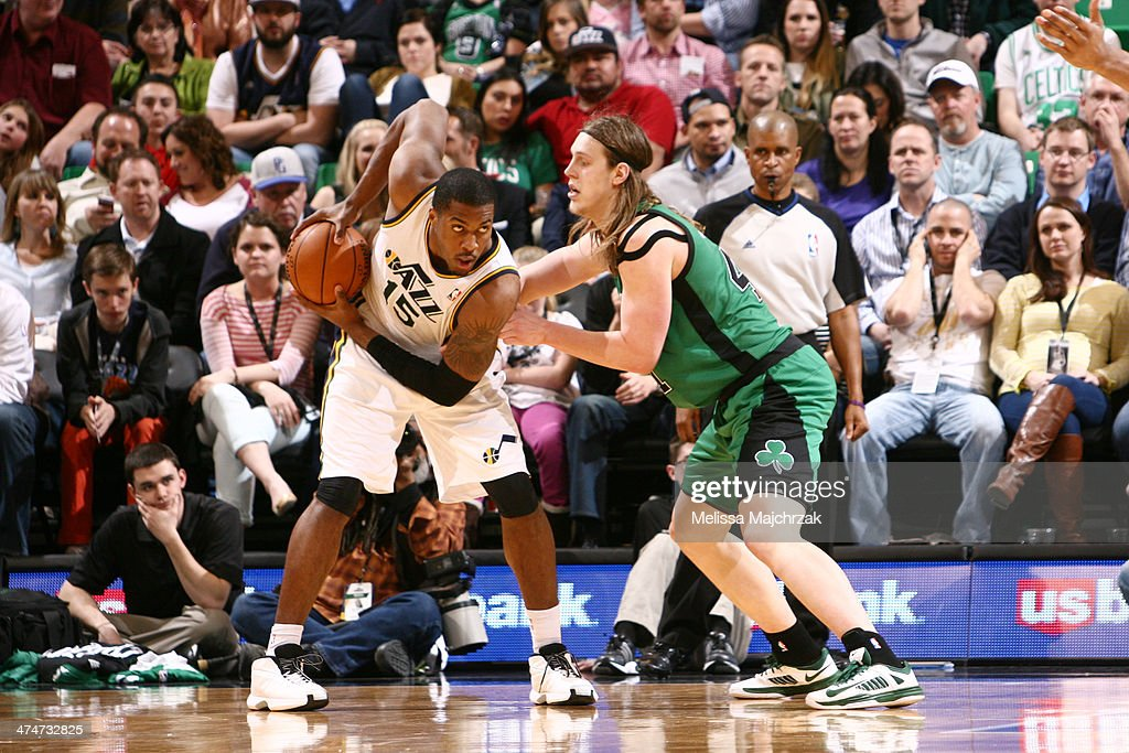 Derrick Favors of the Utah Jazz controls the ball against Kelly Olynyk of the Boston Celtics at EnergySolutions Arena on February 24 2014 in Salt...