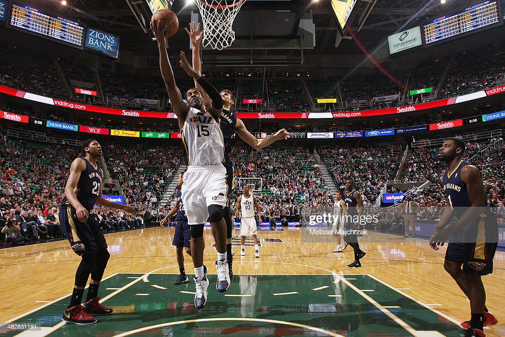Derrick Favors #15 of the Utah Jazz drive to the basket by Luke Babbitt #8 of the New Orleans Pelicans at EnergySolutions Arena on April 04, 2014 in Salt Lake City, Utah.