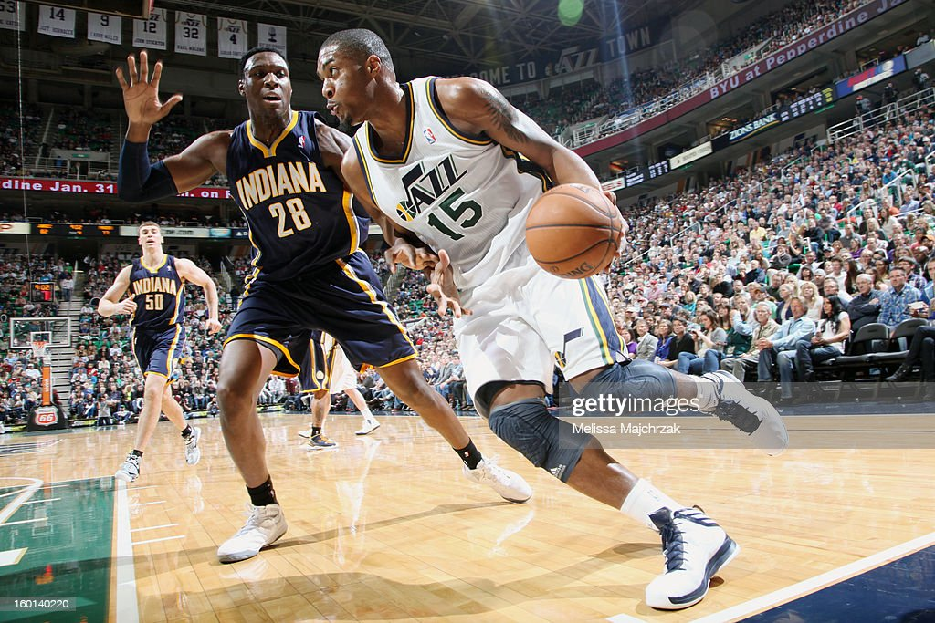<a gi-track='captionPersonalityLinkClicked' href=/galleries/search?phrase=Derrick+Favors&family=editorial&specificpeople=5792014 ng-click='$event.stopPropagation()'>Derrick Favors</a> #15 of the Utah Jazz drives against <a gi-track='captionPersonalityLinkClicked' href=/galleries/search?phrase=Ian+Mahinmi&family=editorial&specificpeople=740196 ng-click='$event.stopPropagation()'>Ian Mahinmi</a> #28 of the Indiana Pacers at Energy Solutions Arena on January 26, 2013 in Salt Lake City, Utah.