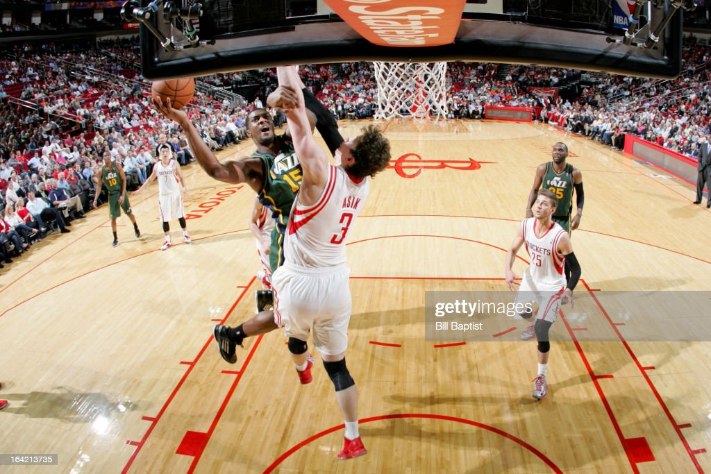 <a gi-track='captionPersonalityLinkClicked' href=/galleries/search?phrase=Derrick+Favors&family=editorial&specificpeople=5792014 ng-click='$event.stopPropagation()'>Derrick Favors</a> #15 of the Utah Jazz drives to the basket against <a gi-track='captionPersonalityLinkClicked' href=/galleries/search?phrase=Omer+Asik&family=editorial&specificpeople=4946055 ng-click='$event.stopPropagation()'>Omer Asik</a> #3 of the Houston Rockets on March 20, 2013 at the Toyota Center in Houston, Texas.