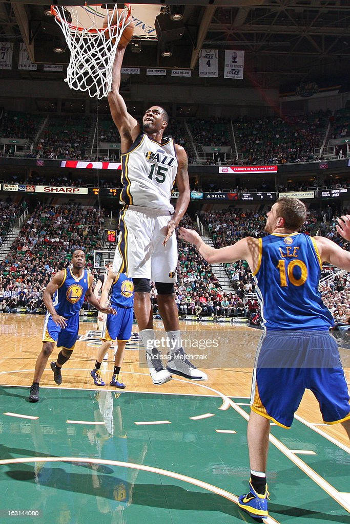 Derrick Favors #15 of the Utah Jazz drives to the basket against the Golden State Warriors at Energy Solutions Arena on February 19, 2013 in Salt Lake City, Utah.