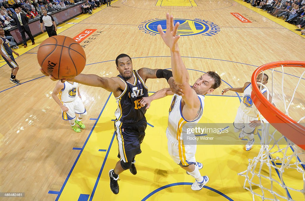 Derrick Favors of the Utah Jazz drives to the basket against the Golden State Warriors on April 6 2014 at Oracle Arena in Oakland California NOTE TO...