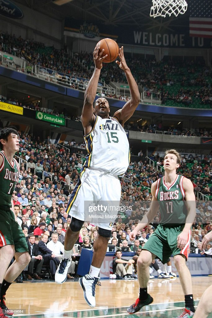 <a gi-track='captionPersonalityLinkClicked' href=/galleries/search?phrase=Derrick+Favors&family=editorial&specificpeople=5792014 ng-click='$event.stopPropagation()'>Derrick Favors</a> #15 of the Utah Jazz drives to the hoop against <a gi-track='captionPersonalityLinkClicked' href=/galleries/search?phrase=Ersan+Ilyasova&family=editorial&specificpeople=557070 ng-click='$event.stopPropagation()'>Ersan Ilyasova</a> #7 and Mike Dunleavy #17 of the Milwaukee Bucks at Energy Solutions Arena on February 06, 2013 in Salt Lake City, Utah.