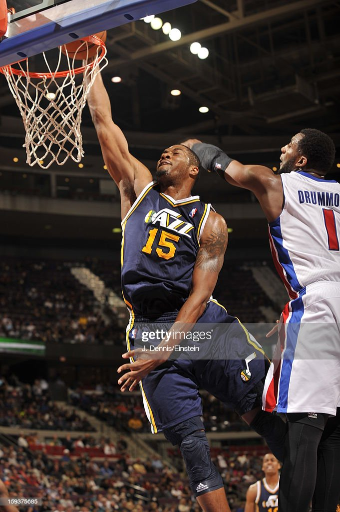 Derrick Favors #15 of the Utah Jazz dunks against Andre Drummond #1 of the Detroit Pistons on January 12, 2013 at The Palace of Auburn Hills in Auburn Hills, Michigan.