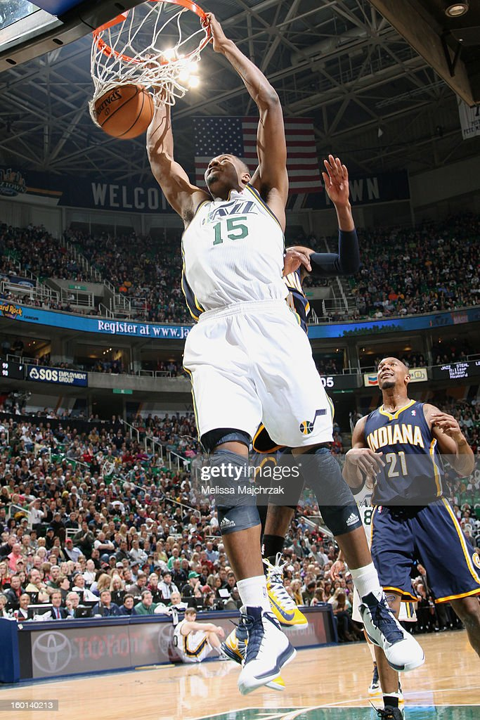 <a gi-track='captionPersonalityLinkClicked' href=/galleries/search?phrase=Derrick+Favors&family=editorial&specificpeople=5792014 ng-click='$event.stopPropagation()'>Derrick Favors</a> #15 of the Utah Jazz dunks against David West #21 of the Indiana Pacers at Energy Solutions Arena on January 26, 2013 in Salt Lake City, Utah.