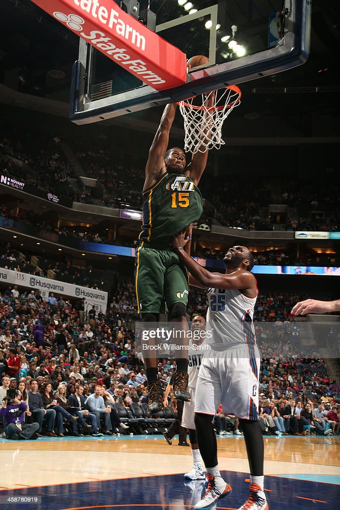 Derrick Favors #15 of the Utah Jazz dunks against the Charlotte Bobcats during the game at the Time Warner Cable Arena on December 21, 2013 in Charlotte, North Carolina.