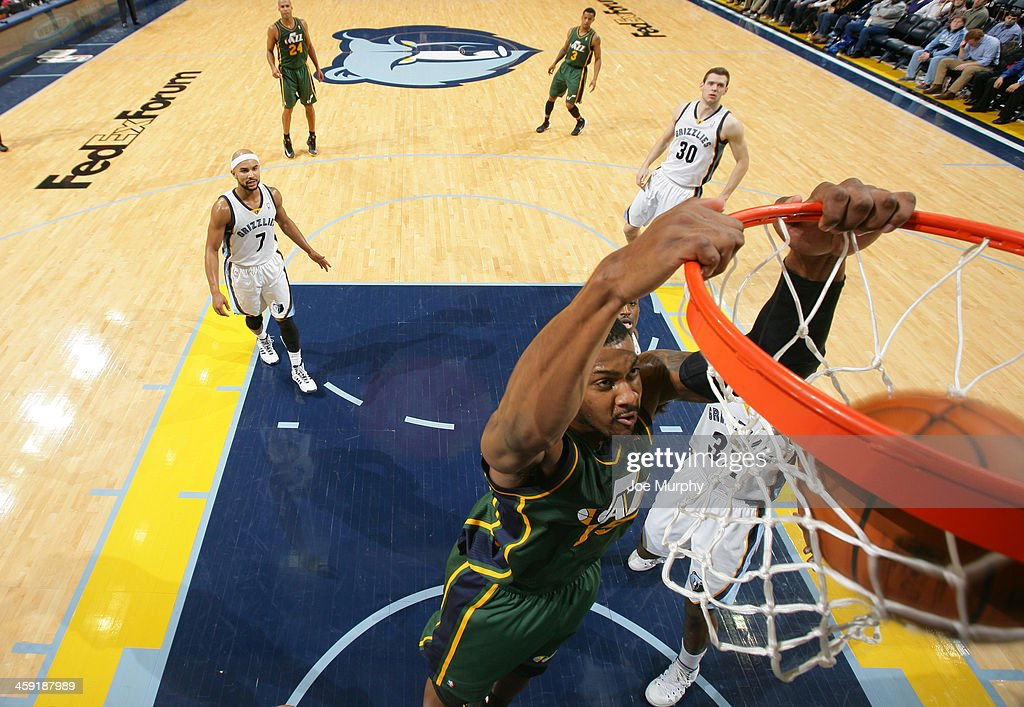 <a gi-track='captionPersonalityLinkClicked' href=/galleries/search?phrase=Derrick+Favors&family=editorial&specificpeople=5792014 ng-click='$event.stopPropagation()'>Derrick Favors</a> #15 of the Utah Jazz dunks against the Memphis Grizzlies on December 23, 2013 at FedExForum in Memphis, Tennessee.