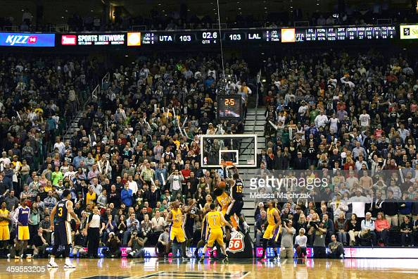 Derrick Favors of the Utah Jazz dunks teammate Gordon Hayward's rebound to take the last second lead over the Los Angeles Lakers at EnergySolutions...