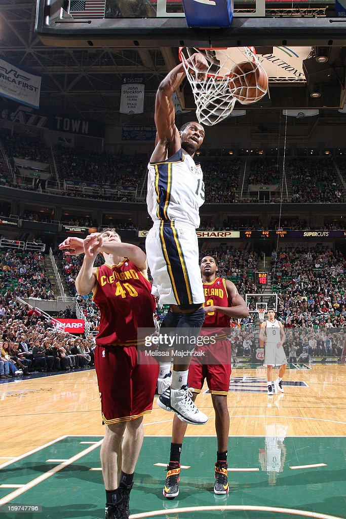 <a gi-track='captionPersonalityLinkClicked' href=/galleries/search?phrase=Derrick+Favors&family=editorial&specificpeople=5792014 ng-click='$event.stopPropagation()'>Derrick Favors</a> #15 of the Utah Jazz dunks the ball against the Cleveland Cavaliers at Energy Solutions Arena on January 19, 2013 in Salt Lake City, Utah.