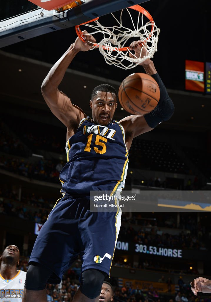 <a gi-track='captionPersonalityLinkClicked' href=/galleries/search?phrase=Derrick+Favors&family=editorial&specificpeople=5792014 ng-click='$event.stopPropagation()'>Derrick Favors</a> #15 of the Utah Jazz dunks the ball against the Denver Nuggets on December 13, 2013 at the Pepsi Center in Denver, Colorado.