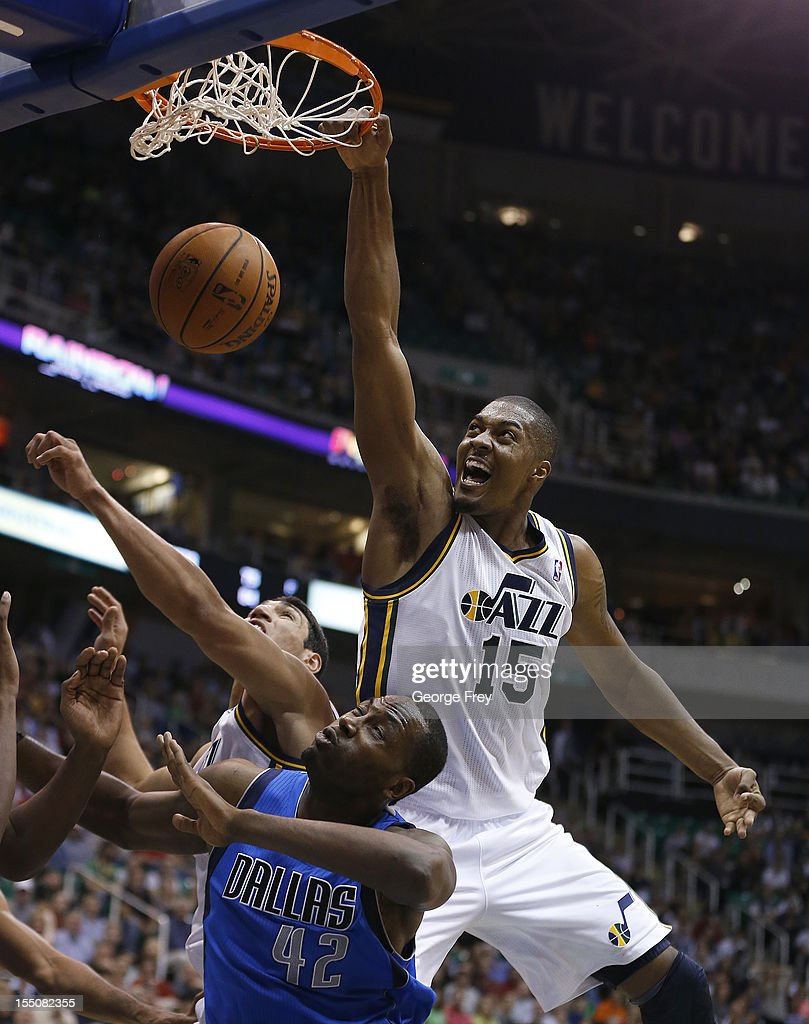 Derrick Favors of the Utah Jazz dunks the ball over Elton Brand of the Dallas Mavericks during the second half of an NBA game October 31 2012 at...