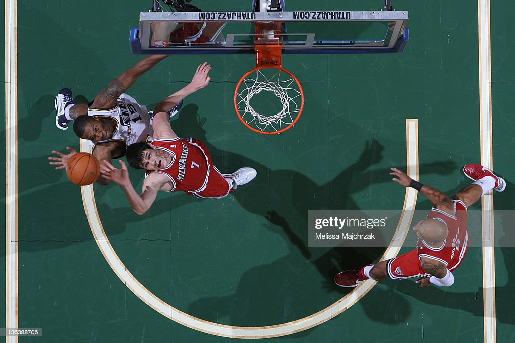 Derrick Favors of the Utah Jazz goes for the rebound against Ersan Ilyasova of the Milwaukee Bucks at Energy Solutions Arena on January 03 2012 in...