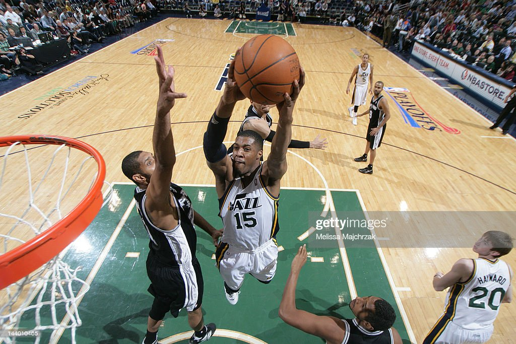 <a gi-track='captionPersonalityLinkClicked' href=/galleries/search?phrase=Derrick+Favors&family=editorial&specificpeople=5792014 ng-click='$event.stopPropagation()'>Derrick Favors</a> #15 of the Utah Jazz goes to the basket against <a gi-track='captionPersonalityLinkClicked' href=/galleries/search?phrase=Tim+Duncan&family=editorial&specificpeople=201467 ng-click='$event.stopPropagation()'>Tim Duncan</a> #21 of the San Antonio Spurs in Game Four of the Western Conference Quarterfinals during the 2012 NBA Playoffs at Energy Solutions Arena on May 7, 2012 in Salt Lake City, Utah.