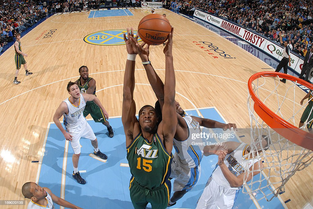 Derrick Favors #15 of the Utah Jazz goes up for a rebound against Kenneth Faried #35 of the Denver Nuggets on January 5, 2013 at the Pepsi Center in Denver, Colorado.