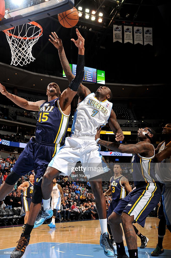 <a gi-track='captionPersonalityLinkClicked' href=/galleries/search?phrase=Derrick+Favors&family=editorial&specificpeople=5792014 ng-click='$event.stopPropagation()'>Derrick Favors</a> #15 of the Utah Jazz goes up for the layup against the Denver Nuggets on December 13, 2013 at the Pepsi Center in Denver, Colorado.