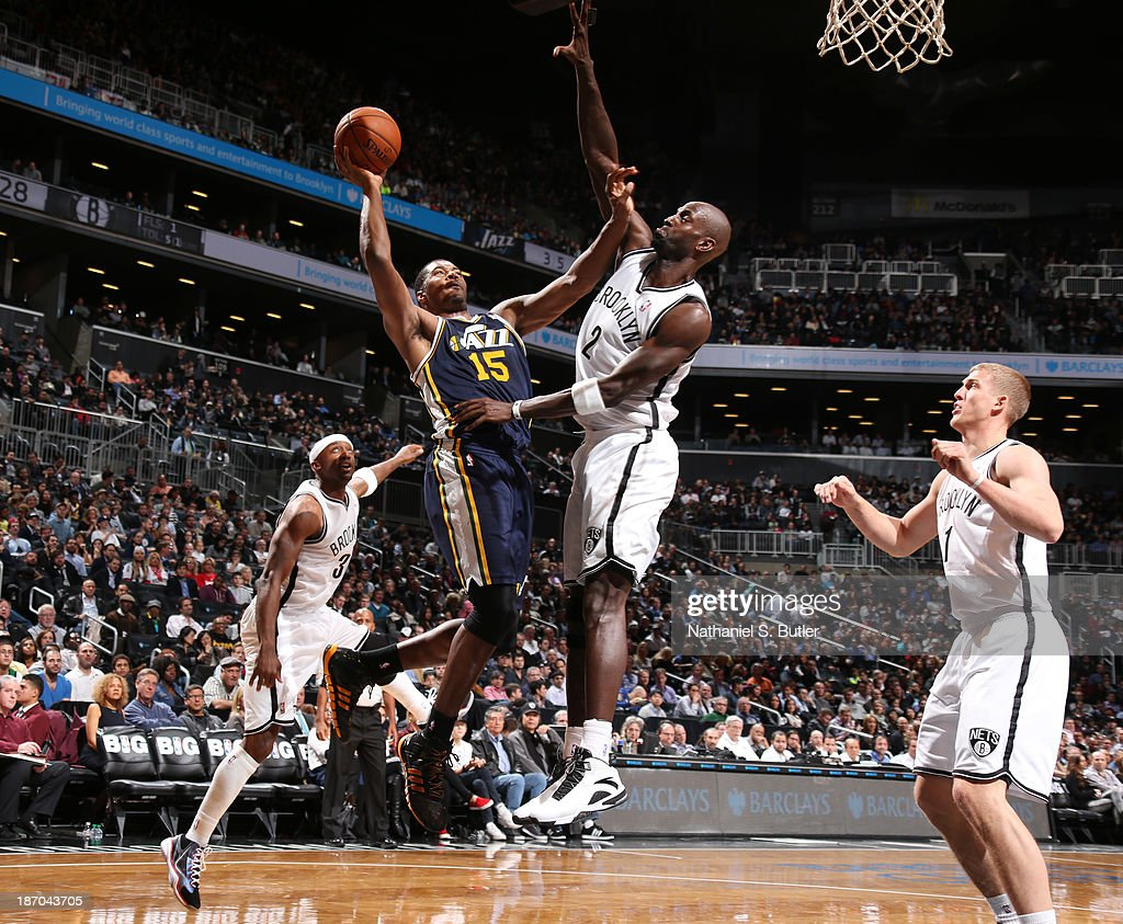 Derrick Favors #15 of the Utah Jazz goes up to shoot against Kevin Garnett #2 of the Brooklyn Nets during a game at Barclays Center on November 5, 2013 in the Brooklyn borough of New York City.