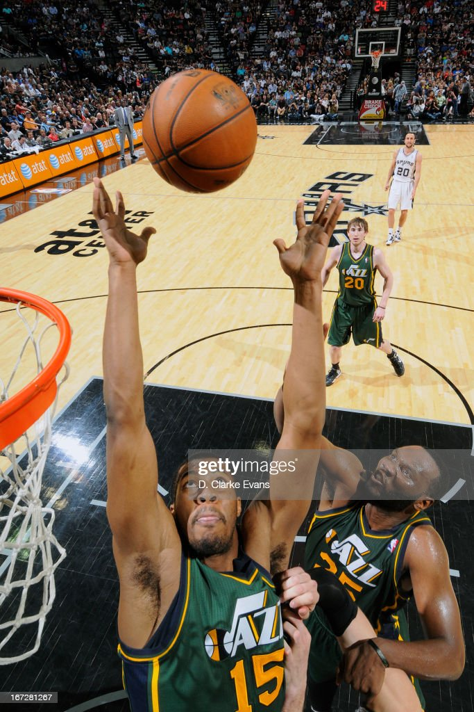 Derrick Favors #15 of the Utah Jazz grabs a rebound against against the San Antonio Spurs on March 22, 2013 at the AT&T Center in San Antonio, Texas.