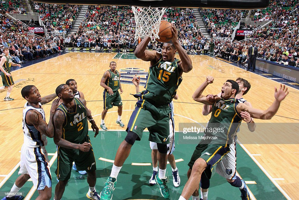 <a gi-track='captionPersonalityLinkClicked' href=/galleries/search?phrase=Derrick+Favors&family=editorial&specificpeople=5792014 ng-click='$event.stopPropagation()'>Derrick Favors</a> #15 of the Utah Jazz grabs a rebound against the Memphis Grizzlies at Energy Solutions Arena on March 16, 2013 in Salt Lake City, Utah.