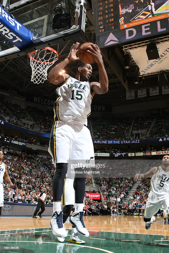 <a gi-track='captionPersonalityLinkClicked' href=/galleries/search?phrase=Derrick+Favors&family=editorial&specificpeople=5792014 ng-click='$event.stopPropagation()'>Derrick Favors</a> #15 of the Utah Jazz grabs a rebound against the Minnesota Timberwolves at Energy Solutions Arena on April 12, 2013 in Salt Lake City, Utah.