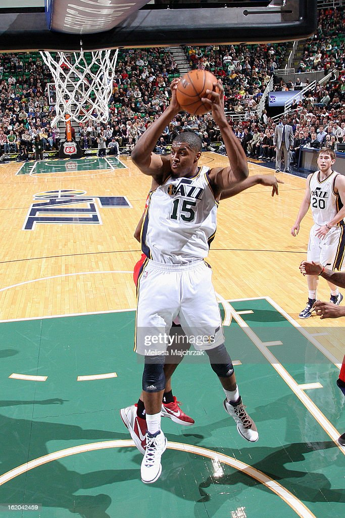 <a gi-track='captionPersonalityLinkClicked' href=/galleries/search?phrase=Derrick+Favors&family=editorial&specificpeople=5792014 ng-click='$event.stopPropagation()'>Derrick Favors</a> #15 of the Utah Jazz grabs a rebound against the Washington Wizards at Energy Solutions Arena on January 23, 2013 in Salt Lake City, Utah.