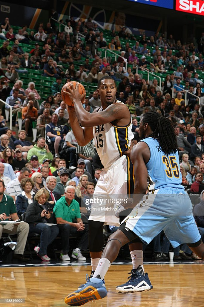 Derrick Favors of the Utah Jazz handles the ball against Kenneth Faried of the Denver Nuggets on October 22 2015 at EnergySolutions Arena in Salt...