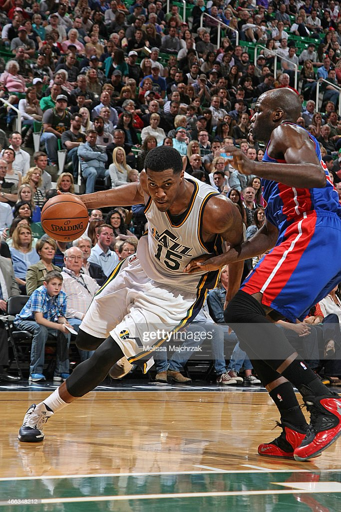 Derrick Favors of the Utah Jazz handles the ball against the Detroit Pistons on March 14 2015 at EnergySolutions Arena in Salt Lake City Utah NOTE TO...