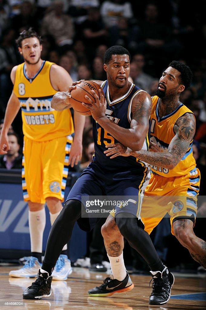 Derrick Favors of the Utah Jazz handles the ball against Wilson Chandler of the Denver Nuggets on February 27 2015 at the Pepsi Center in Denver...