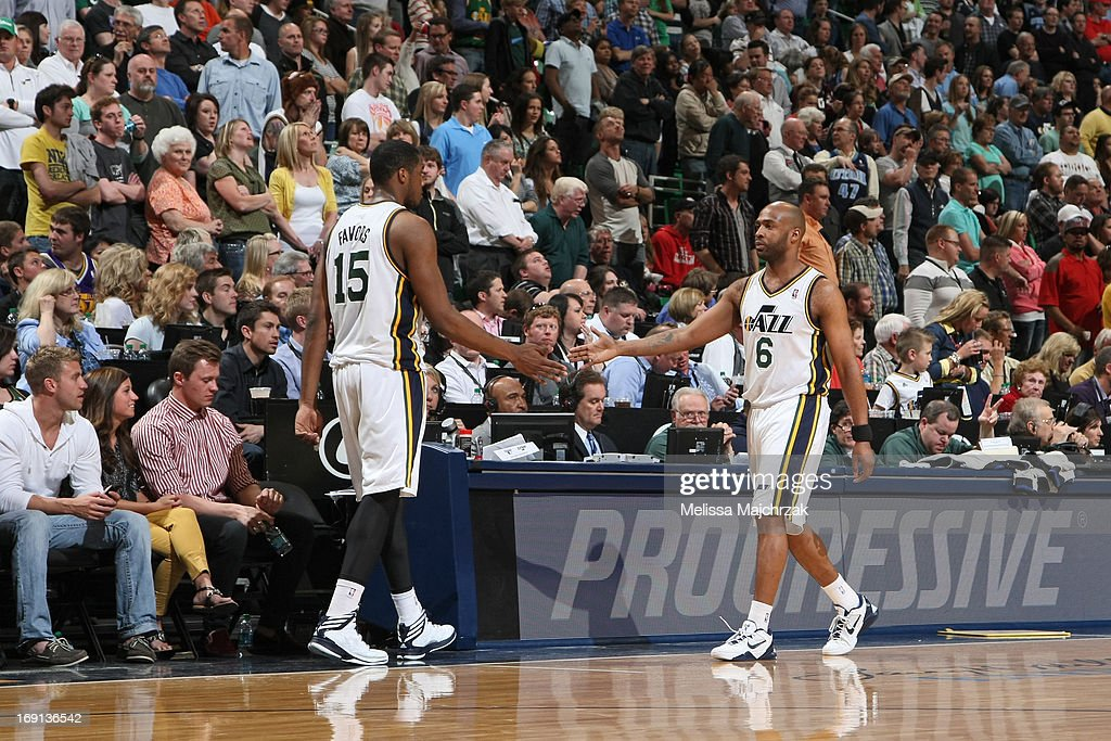 <a gi-track='captionPersonalityLinkClicked' href=/galleries/search?phrase=Derrick+Favors&family=editorial&specificpeople=5792014 ng-click='$event.stopPropagation()'>Derrick Favors</a> #15 of the Utah Jazz high fives teammate <a gi-track='captionPersonalityLinkClicked' href=/galleries/search?phrase=Jamaal+Tinsley&family=editorial&specificpeople=202203 ng-click='$event.stopPropagation()'>Jamaal Tinsley</a> #6 during the game against the Minnesota Timberwolves at Energy Solutions Arena on April 12, 2013 in Salt Lake City, Utah.