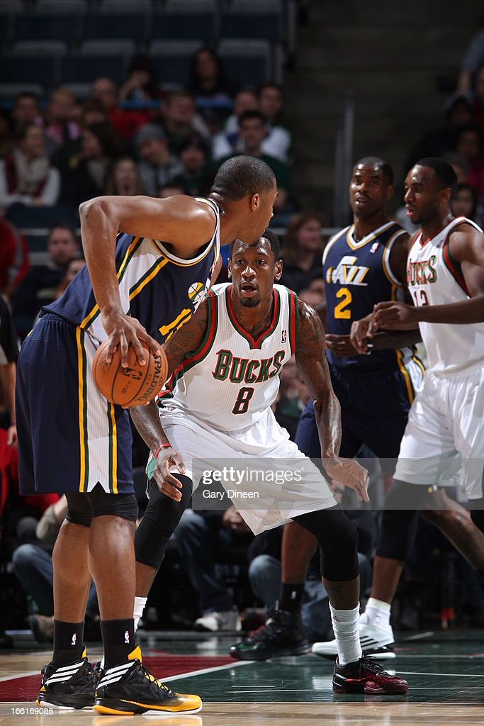 <a gi-track='captionPersonalityLinkClicked' href=/galleries/search?phrase=Derrick+Favors&family=editorial&specificpeople=5792014 ng-click='$event.stopPropagation()'>Derrick Favors</a> #15 of the Utah Jazz looks to pass the ball against Larry Sanders #8 of the Milwaukee Bucks on March 4, 2013 at the BMO Harris Bradley Center in Milwaukee, Wisconsin.