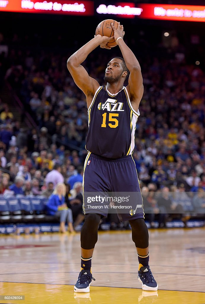 Derrick Favors of the Utah Jazz looks to shoot against the Golden State Warriors during their NBA basketball game at ORACLE Arena on December 23 2015...