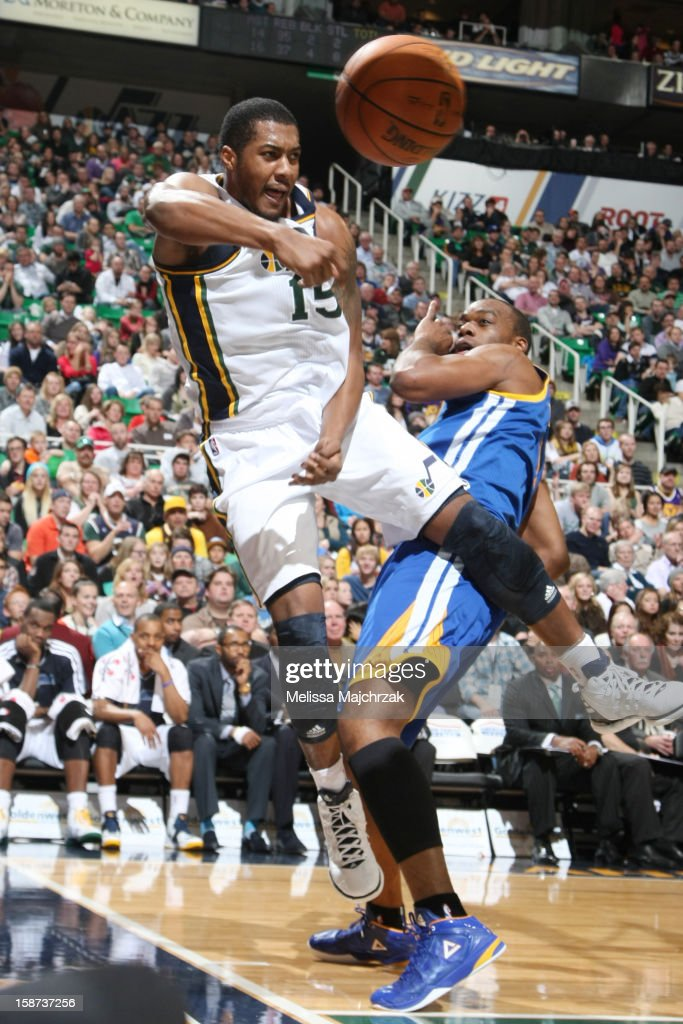 <a gi-track='captionPersonalityLinkClicked' href=/galleries/search?phrase=Derrick+Favors&family=editorial&specificpeople=5792014 ng-click='$event.stopPropagation()'>Derrick Favors</a> #15 of the Utah Jazz passes the ball against <a gi-track='captionPersonalityLinkClicked' href=/galleries/search?phrase=Carl+Landry&family=editorial&specificpeople=4111952 ng-click='$event.stopPropagation()'>Carl Landry</a> #7 of the Golden State Warriors at Energy Solutions Arena on December 26, 2012 in Salt Lake City, Utah.