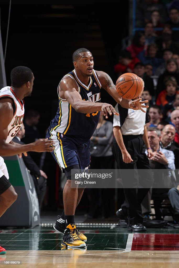 <a gi-track='captionPersonalityLinkClicked' href=/galleries/search?phrase=Derrick+Favors&family=editorial&specificpeople=5792014 ng-click='$event.stopPropagation()'>Derrick Favors</a> #15 of the Utah Jazz passes the ball against the Milwaukee Bucks on March 4, 2013 at the BMO Harris Bradley Center in Milwaukee, Wisconsin.