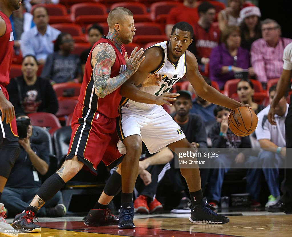 Derrick Favors of the Utah Jazz posts up Chris Andersen of the Miami Heat during a game at American Airlines Arena on December 17 2014 in Miami...