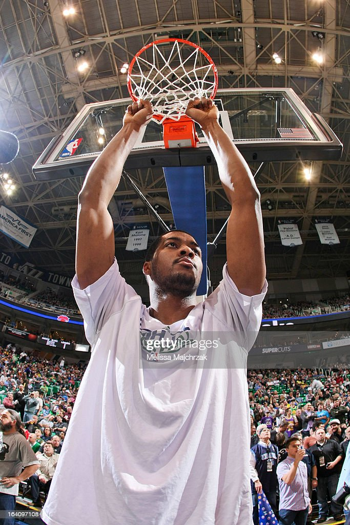 <a gi-track='captionPersonalityLinkClicked' href=/galleries/search?phrase=Derrick+Favors&family=editorial&specificpeople=5792014 ng-click='$event.stopPropagation()'>Derrick Favors</a> #15 of the Utah Jazz pulls on the net before his game against the New York Knicks at Energy Solutions Arena on March 18, 2013 in Salt Lake City, Utah.