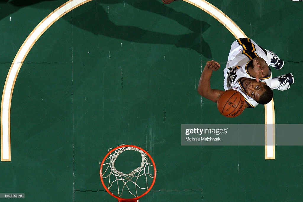 <a gi-track='captionPersonalityLinkClicked' href=/galleries/search?phrase=Derrick+Favors&family=editorial&specificpeople=5792014 ng-click='$event.stopPropagation()'>Derrick Favors</a> #15 of the Utah Jazz reaches for a rebound against the Portland Trail Blazers at Energy Solutions Arena on April 1, 2013 in Salt Lake City, Utah.