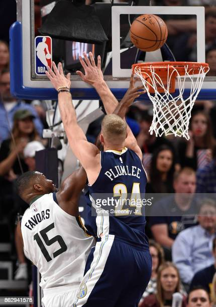 Derrick Favors of the Utah Jazz scores in the second half past the defense of Mason Plumlee of the Denver Nuggets during the 10696 win by the Jazz at...