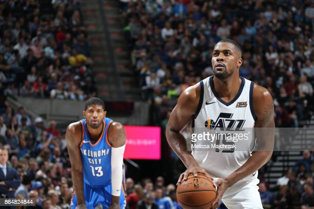 Derrick Favors of the Utah Jazz shoots a free throw against the Oklahoma City Thunder during the game on October 21 2017 at vivintSmartHome Arena in...