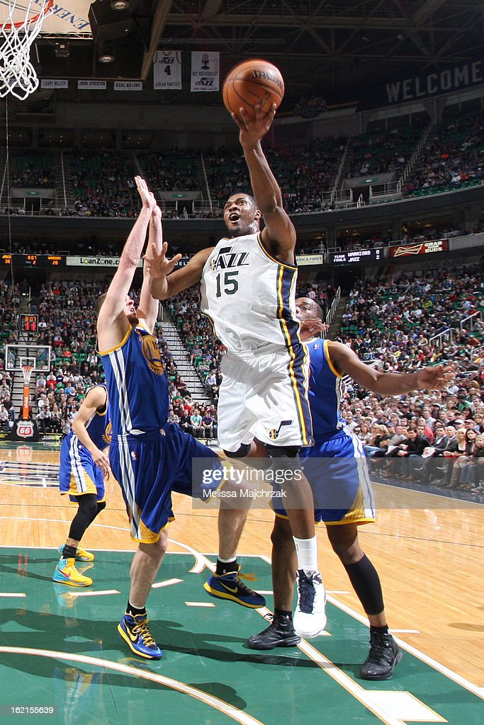 Derrick Favors #15 of the Utah Jazz shoots a layup against David Lee #10 of the Golden State Warriors at Energy Solutions Arena on February 19, 2013 in Salt Lake City, Utah.