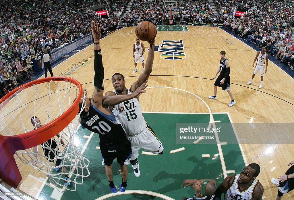 <a gi-track='captionPersonalityLinkClicked' href=/galleries/search?phrase=Derrick+Favors&family=editorial&specificpeople=5792014 ng-click='$event.stopPropagation()'>Derrick Favors</a> #15 of the Utah Jazz shoots against Chris Johnson #20 of the Minnesota Timberwolves at Energy Solutions Arena on April 12, 2013 in Salt Lake City, Utah.