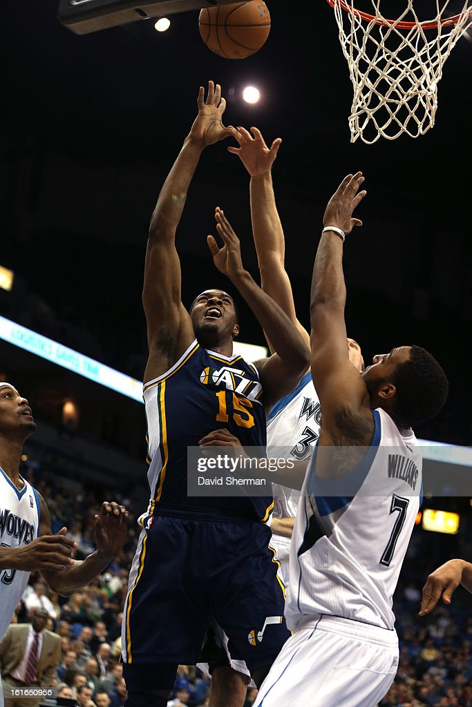 Derrick Favors #15 of the Utah Jazz shoots against Derrick Williams #7 of the Minnesota Timberwolves on February 13, 2013 at Target Center in Minneapolis, Minnesota.