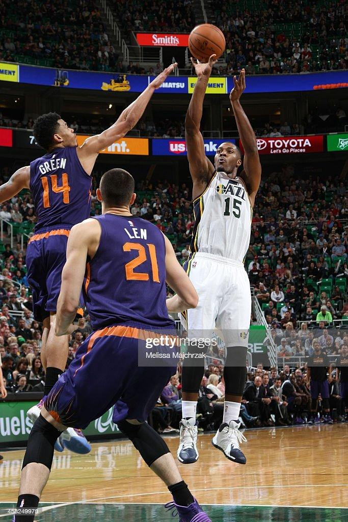 Derrick Favors of the Utah Jazz shoots against Gerald Green of the Phoenix Suns at EnergySolutions Arena on November 1 2014 in Salt Lake City Utah...
