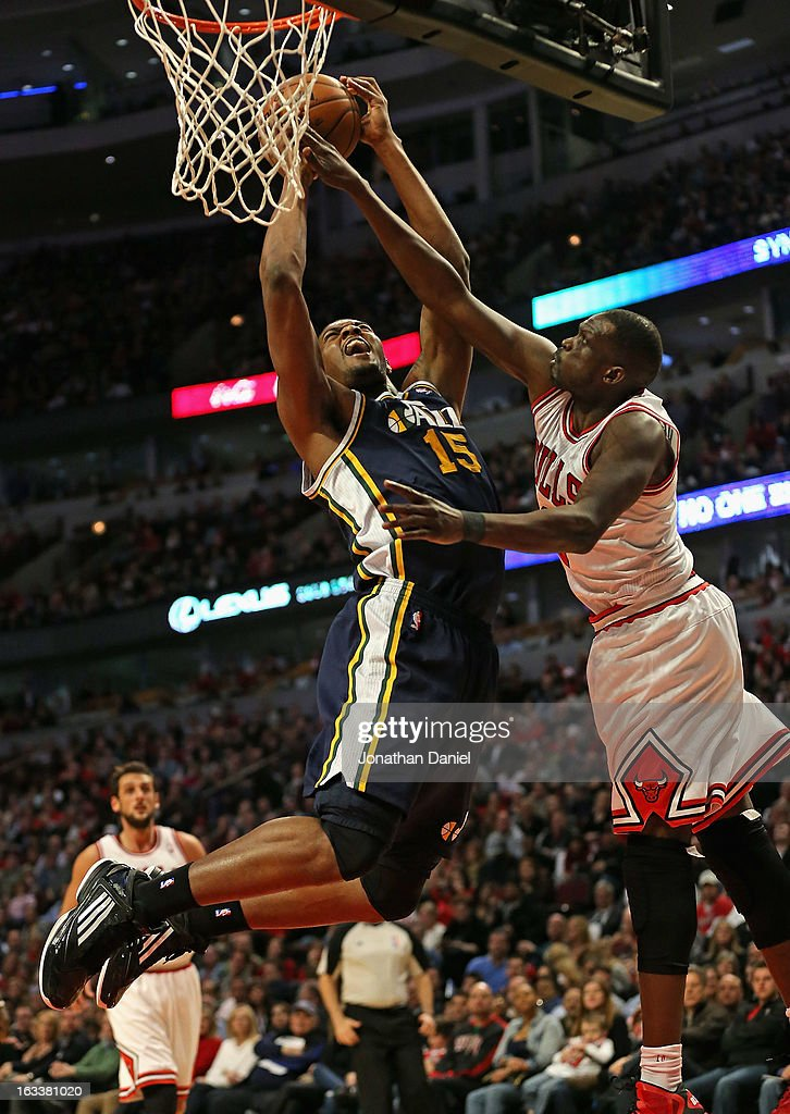 Derrick Favors of the Utah Jazz shoots against Loul Deng of the Chicago Bulls at the United Center on March 8 2013 in Chicago Illinois The Bulls...