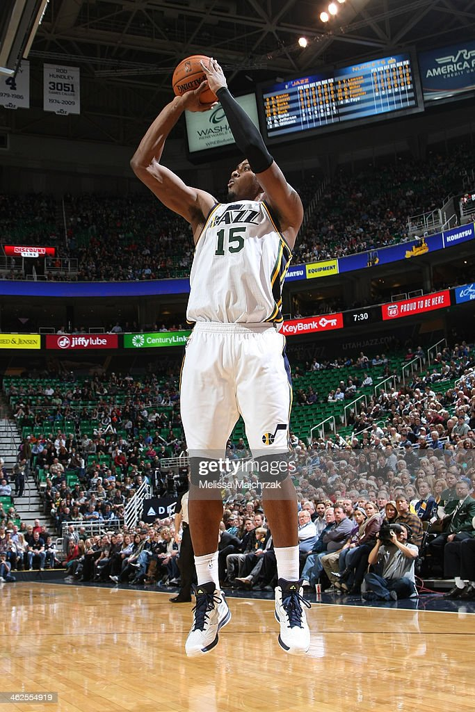 Derrick Favors #15 of the Utah Jazz shoots against the Denver Nuggets at EnergySolutions Arena on January 13, 2014 in Salt Lake City, Utah.