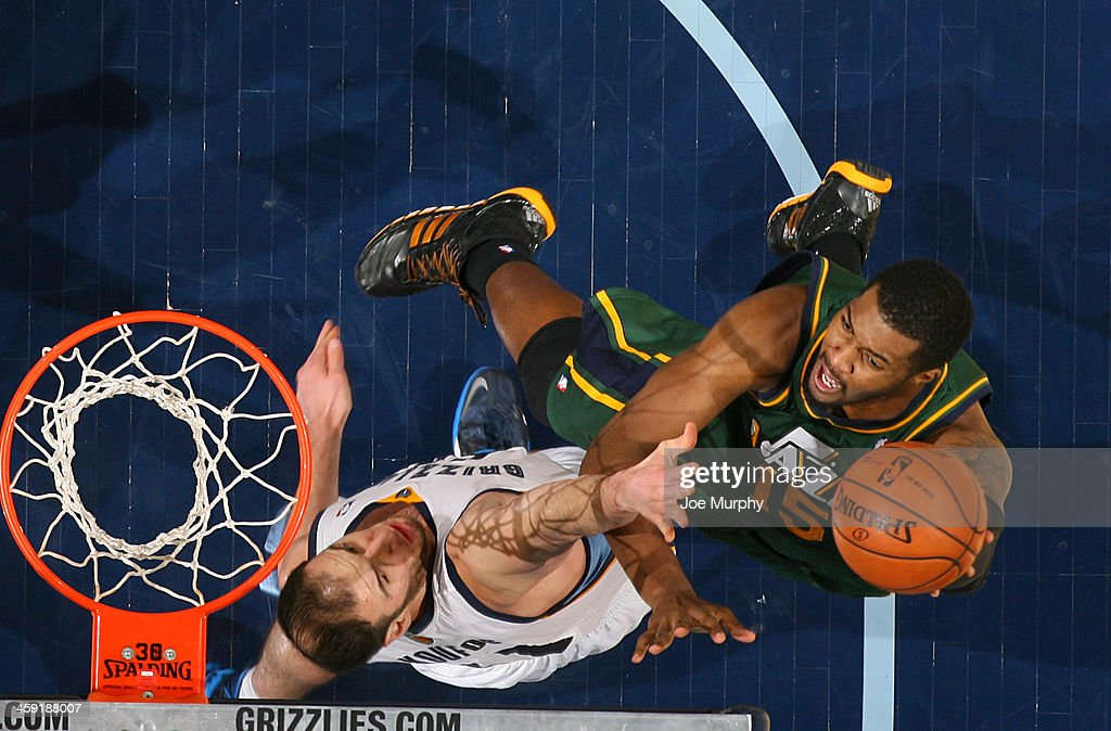 <a gi-track='captionPersonalityLinkClicked' href=/galleries/search?phrase=Derrick+Favors&family=editorial&specificpeople=5792014 ng-click='$event.stopPropagation()'>Derrick Favors</a> #15 of the Utah Jazz shoots against the Memphis Grizzlies on December 23, 2013 at FedExForum in Memphis, Tennessee.