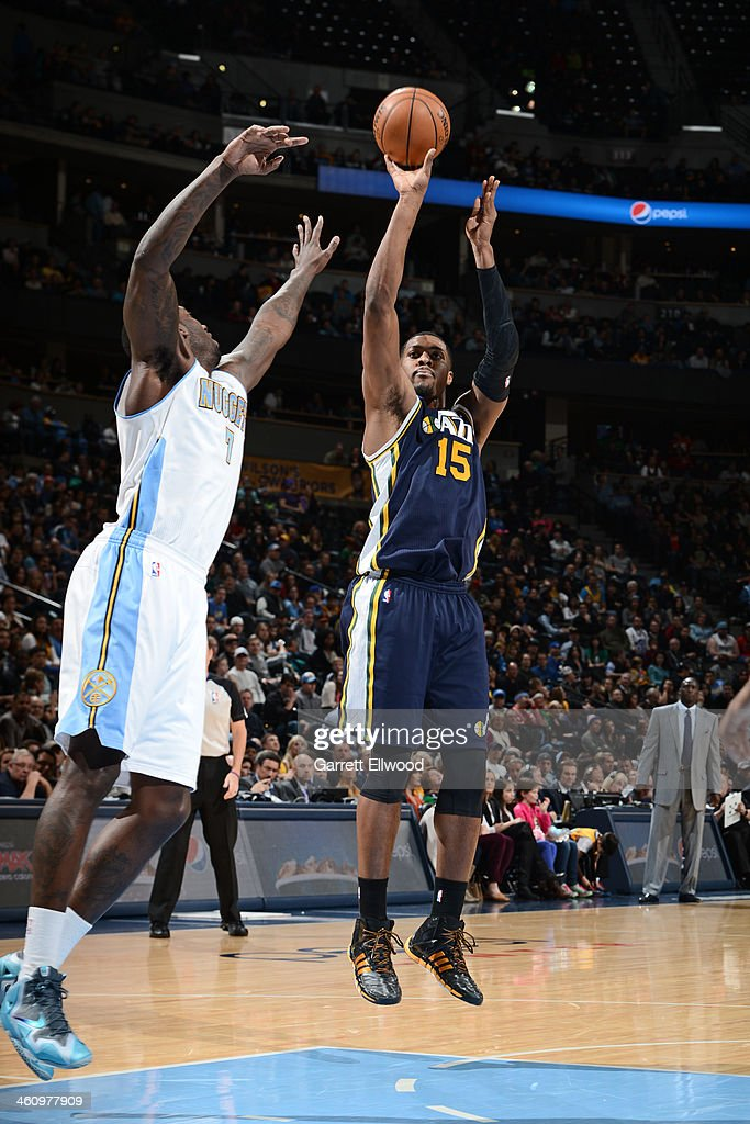 <a gi-track='captionPersonalityLinkClicked' href=/galleries/search?phrase=Derrick+Favors&family=editorial&specificpeople=5792014 ng-click='$event.stopPropagation()'>Derrick Favors</a> #15 of the Utah Jazz shoots the ball against the Denver Nuggets on December 13, 2013 at the Pepsi Center in Denver, Colorado.