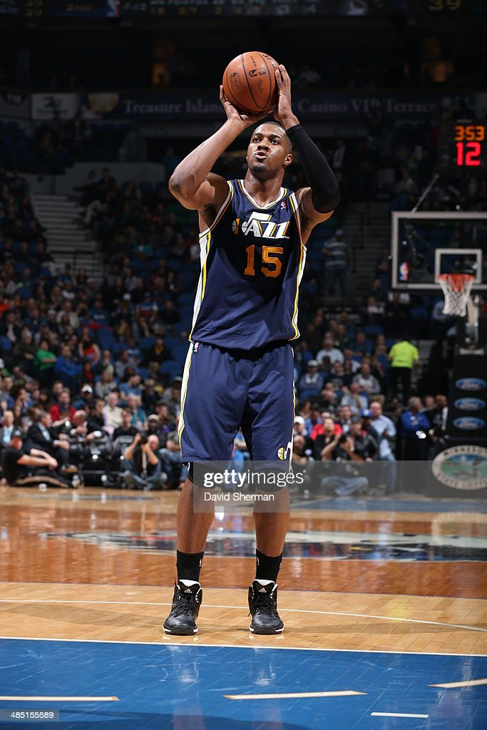 Derrick Favors of the Utah Jazz shoots the ball against the Minnesota Timberwolves during the game on April 16 2014 at Target Center in Minneapolis...