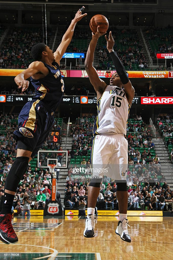 <a gi-track='captionPersonalityLinkClicked' href=/galleries/search?phrase=Derrick+Favors&family=editorial&specificpeople=5792014 ng-click='$event.stopPropagation()'>Derrick Favors</a> #15 of the Utah Jazz takes a shot against the New Orleans Pelicans at EnergySolutions Arena on April 04, 2014 in Salt Lake City, Utah.