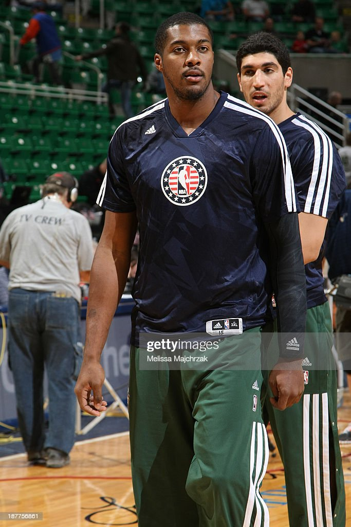 <a gi-track='captionPersonalityLinkClicked' href=/galleries/search?phrase=Derrick+Favors&family=editorial&specificpeople=5792014 ng-click='$event.stopPropagation()'>Derrick Favors</a> #15 of the Utah Jazz warms up before the game against the Denver Nuggets at EnergySolutions Arena on November 11, 2013 in Salt Lake City, Utah.